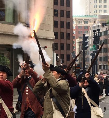 Minutemen firing muskets in downtown Boston