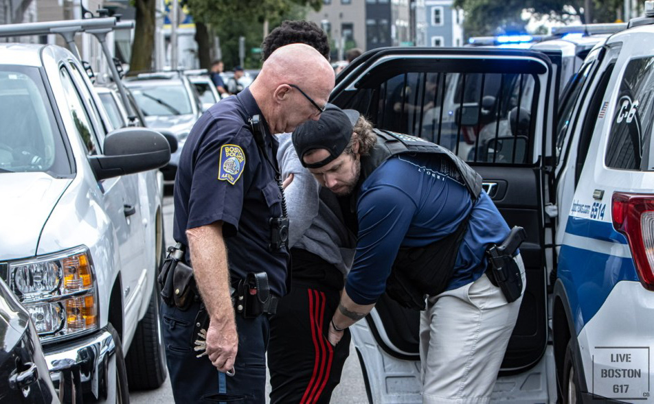 Arrested and being searched