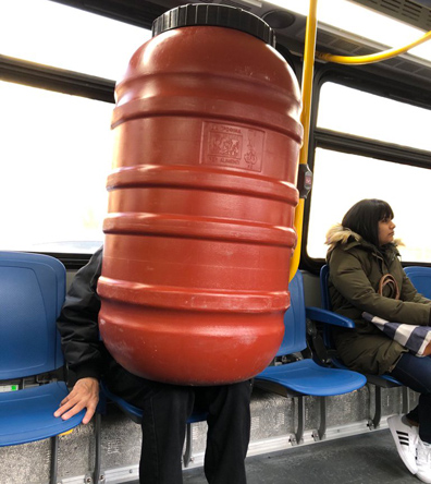 Man with barrel on the 32 bus