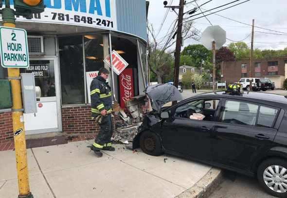 Car into laundromat in Arlington