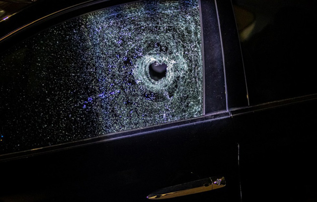 Car window destroyed by bullet