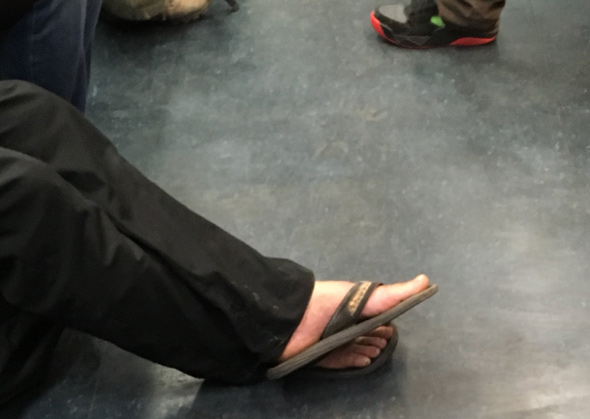 Bare feet on the Blue Line
