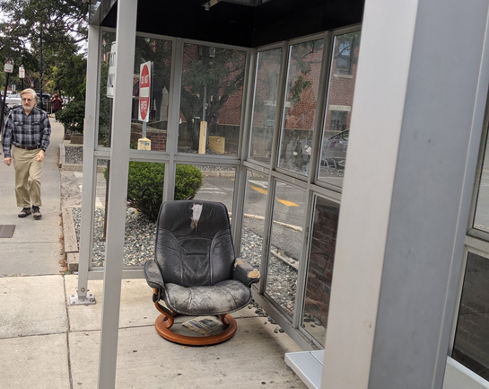 Cushy chair at a Harvard Street bus stop