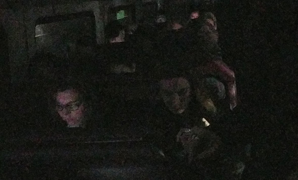 Onboard a darkened, dead Needham Line train near Ruggles