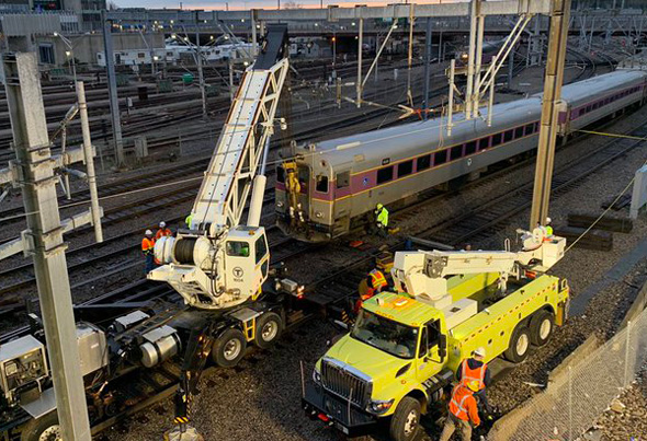 Working to right the derailed train near South Station