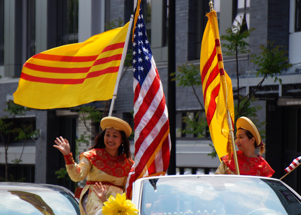 Women with South Vietnamese and American flags