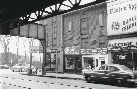Street scene under an el in old Boston