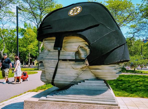 Giant Arthur Fiedler head with a Bruins helmet on