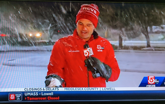Channel 5 reporter with a snowball