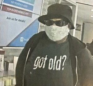 Wanted for bank robbery: Man wearing Got Old shirt