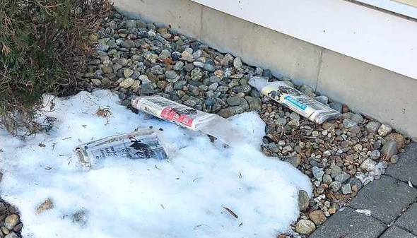 Globe Direct circulars lying in the snow in East Boston