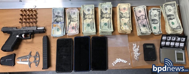 Seized drugs, gun and money
