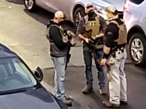 Federal agents on McLellan Street