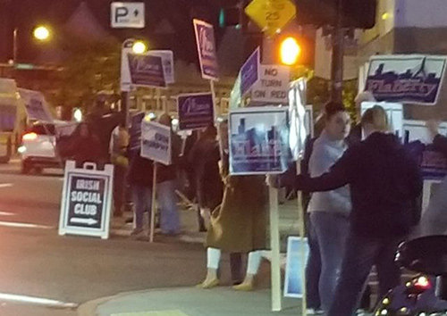 Human billboards on Centre Street in West Roxbury.