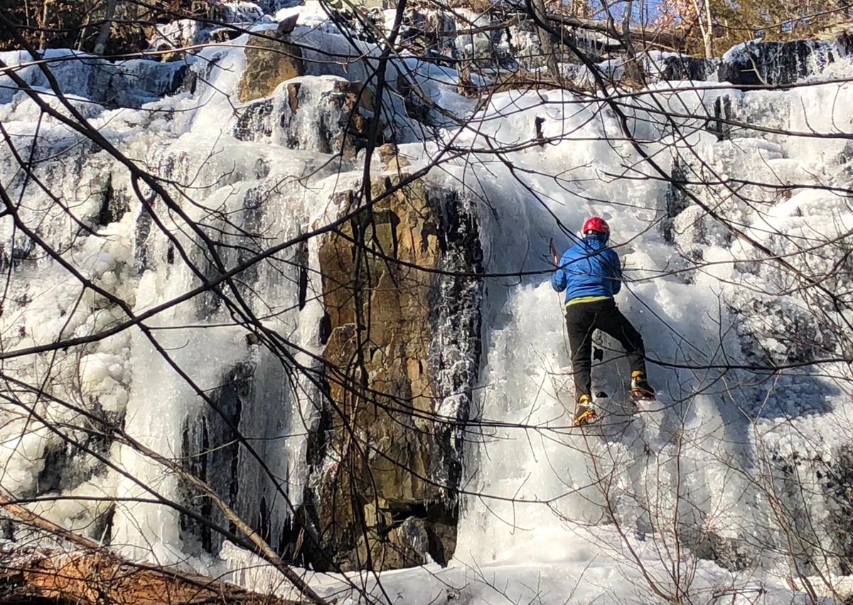Climbing a still frozen waterfall in Medford