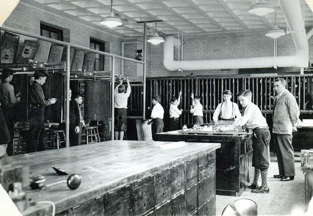 Boys in knickers in old Boston shop class