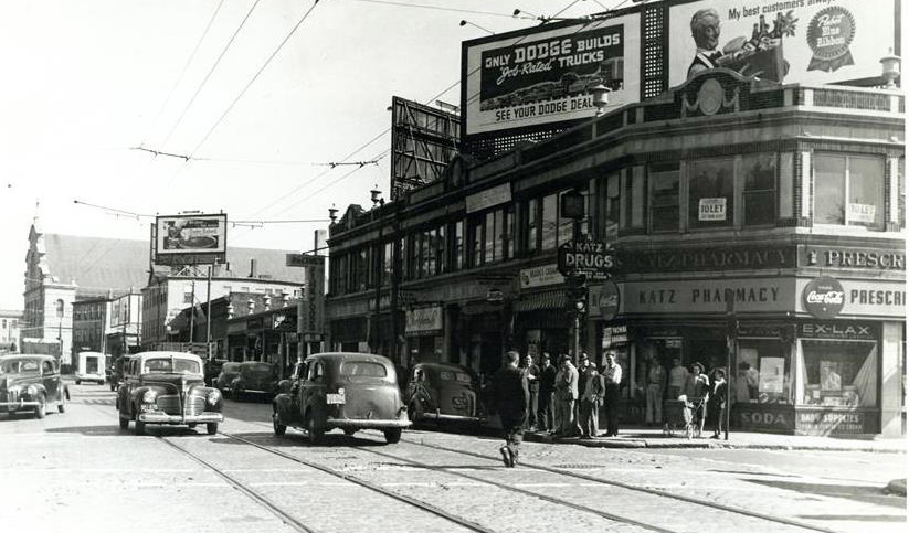 Street scene in old Boston, featuring trolley tracks and Katz Pharmacy