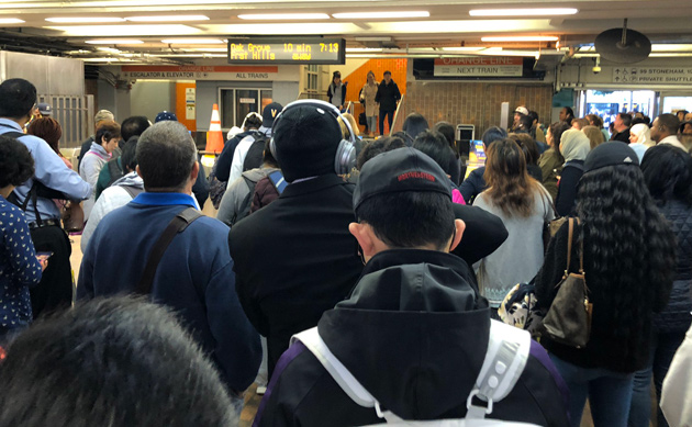 People waiting at Malden Center on the Orange Line