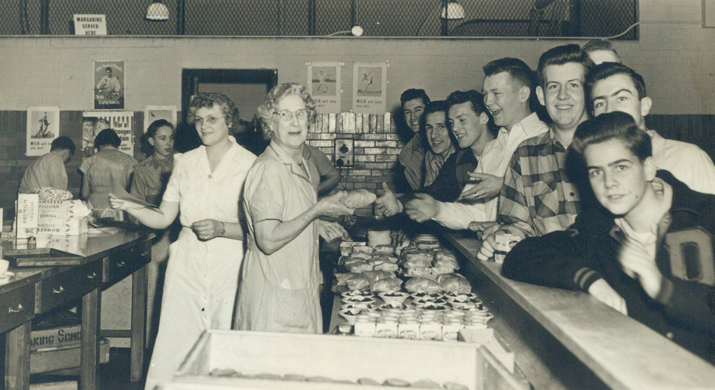 Guys being served at a counter in old Boston