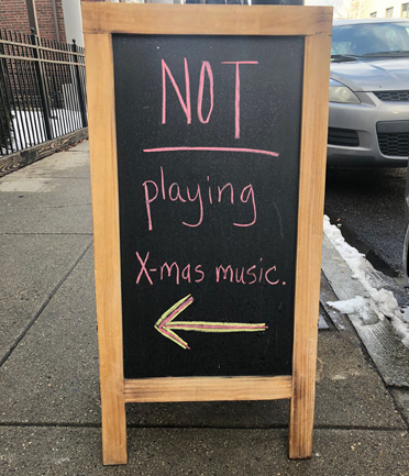 Sign that reads: NOT playing Xmas music