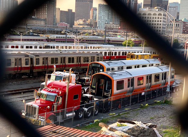 Orange Line cars being dropped off at a Red Line yard
