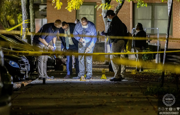 Detectives examine evidence on Parker Street