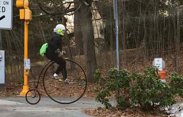 Man on a penny farthing in Lexington