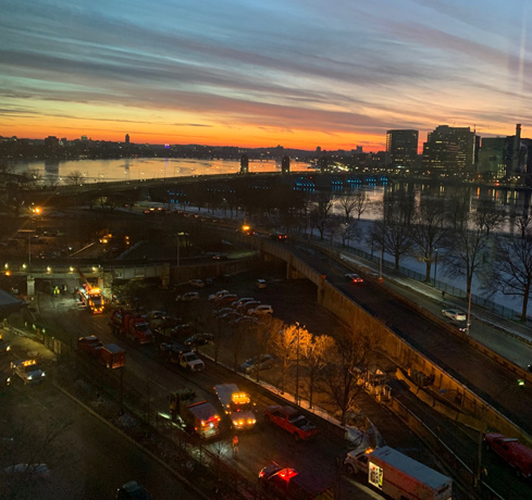 Sunset over Storrow Drive, still bocked due to transformer spill