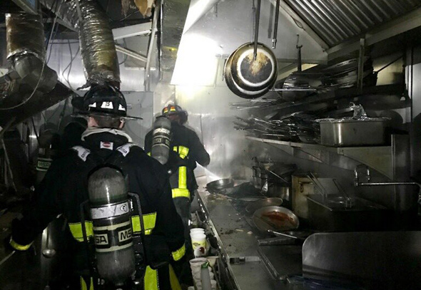 Firefighters in Trattoria il Panino kitchen