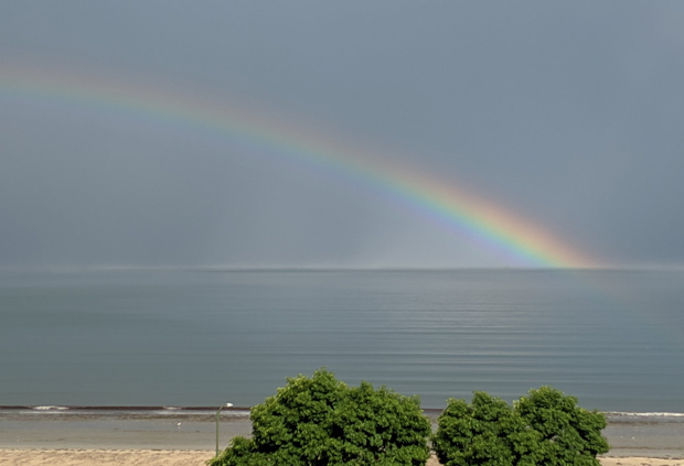 Rainbow over waters off Revere