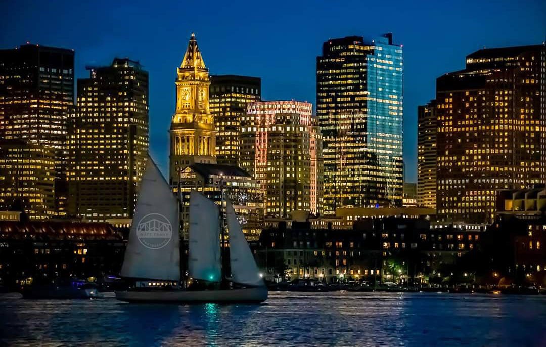 Sloop passes in front of downtown Boston