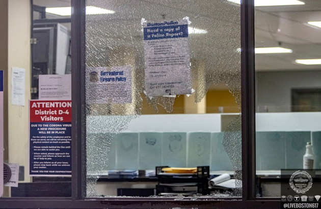 Smashed window at D-4 police station