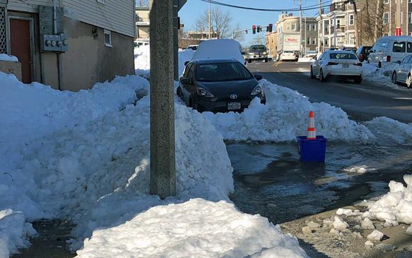 Person shoveled out car onto sidewalk in Dorchester