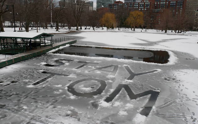 Message written in the ice in the Public Garden lagoon: Stay Tom