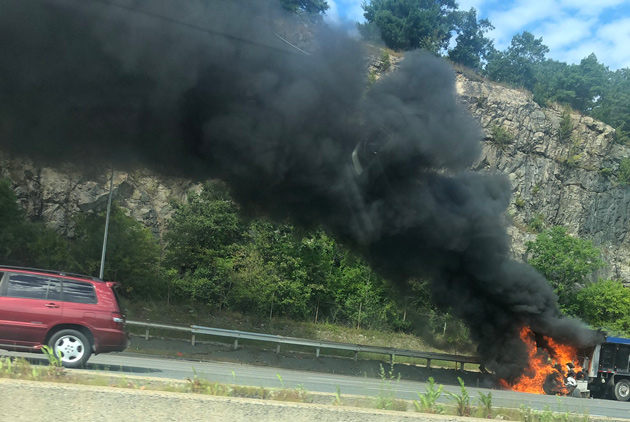 Truck on fire on I-93