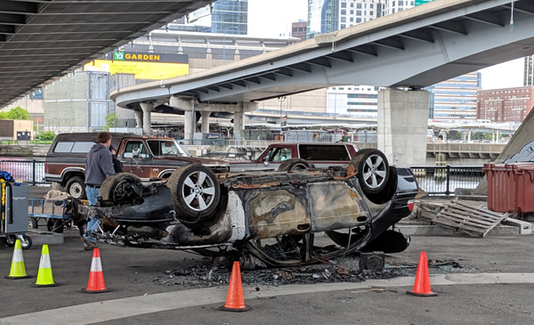Car turned turtle under the Zakim Bridge