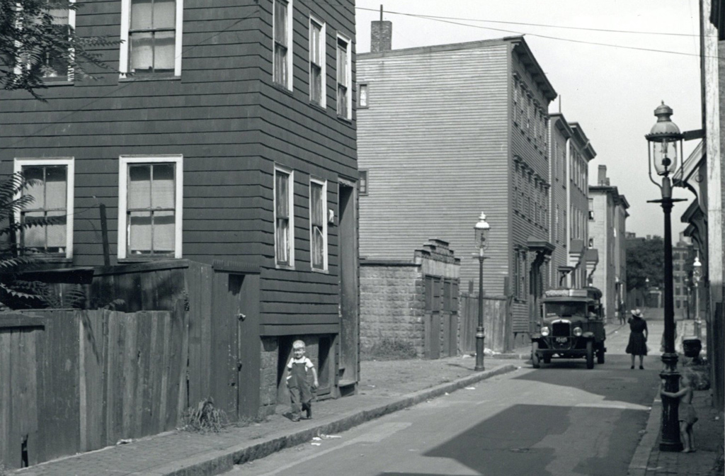 Street scene in old Boston with two young kids