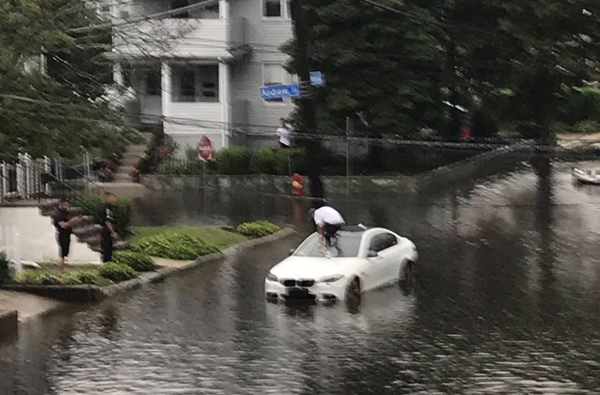 Man abandoning his car in Malden