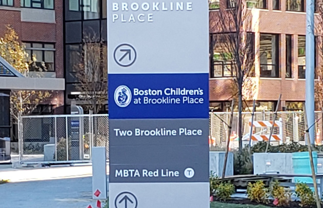 Sign in Brookline Village points to Red Line station, even though the Red Line goes nowhere near there