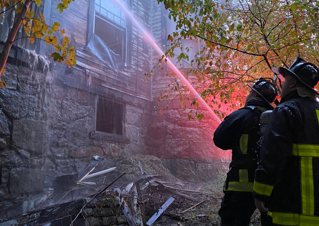 Firefighters at 46 Beacon St. in Hyde Park
