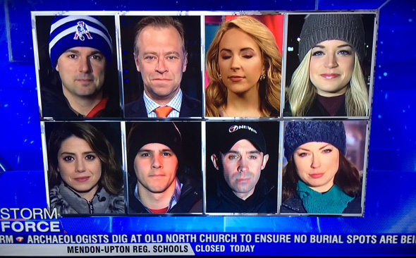 Eight reporters in the snow