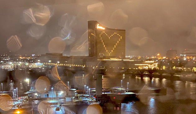 Encore Casino lit up like a heart in the rain