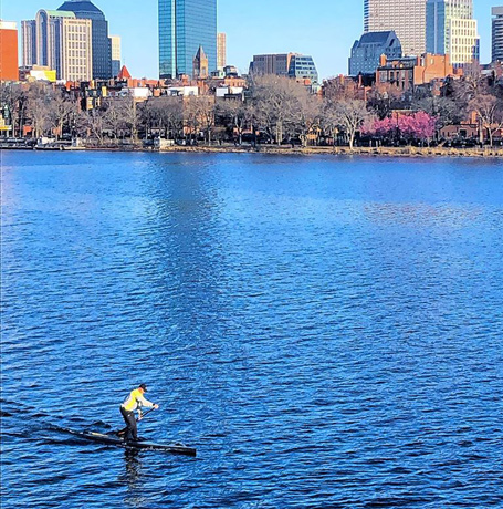 Man on a paddleboard in the Charles River