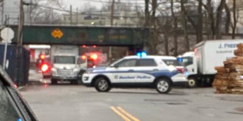 Truck wedged under MBTA bridge in Dorchester