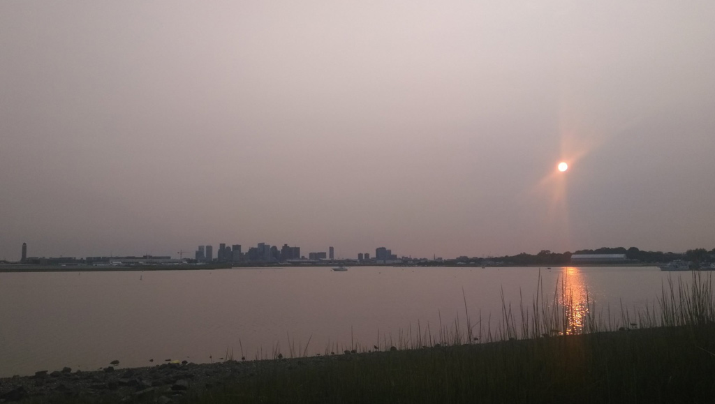 Hazy sunset over Boston Harbor from East Boston