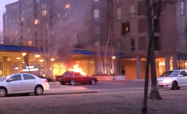 Car on fire in Brookline