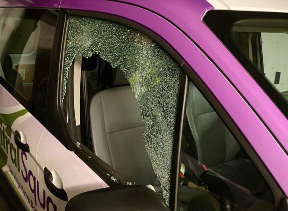Smashed window in floral van