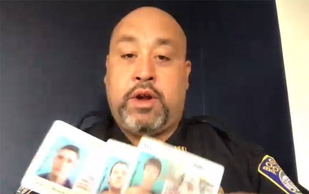 Det. Eddie Hernandez with fake Massachusetts licenses from Applebee's