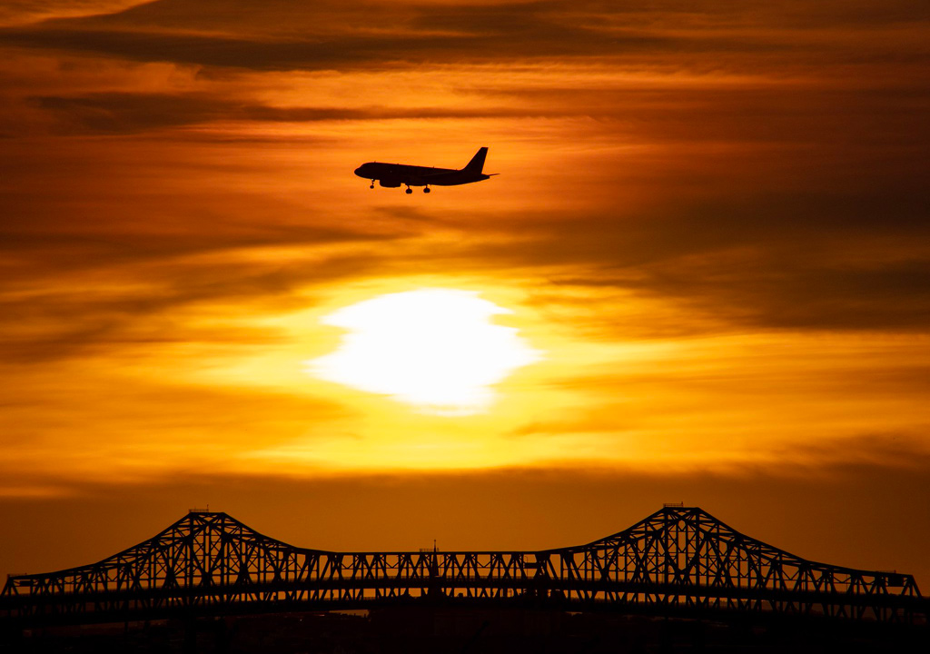 Sunset and jet over the Tobin Bridge