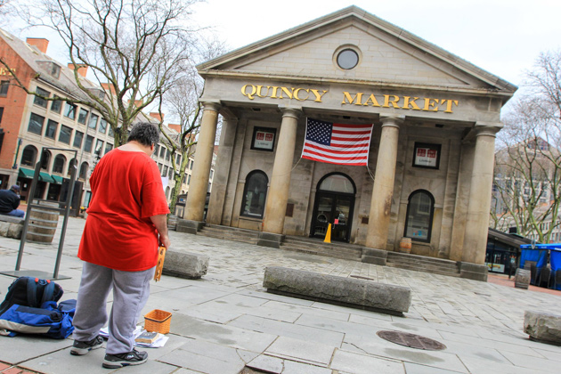 Lonely performer in front of the Quincy Market building